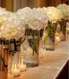 in shorter vases with candles