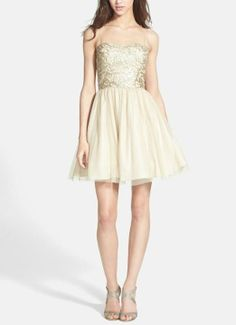 Such a pretty gold prom dress. Love the tulle and sparkly embellishments.