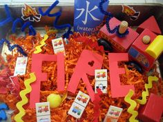 October Week Fire Safety Fire Sensory Bin + 9 Other Activities/Crafts for Fire Prevention Week Sensory Tubs, Sensory Boxes, Sensory Play, Fire Safety Crafts, Fire Safety Week, Preschool Themes, Preschool Activities, Fire Truck Activities, Preschool Prep