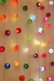 A collection of ambient ball LED fairy lights by Blaze On, arranged hanging vertically.