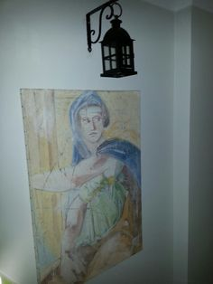 A gesso paint antique looking with candle/lantern hanging on top when candle is on the reflection over the paint is amazing