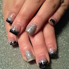Acrylic glitter nails in silver fading to black, and a full silver 'party nail'