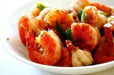 This is my favorite way to eat prawns! It only takes 15 minutes to make and the brandy adds unexpected sweetness and depth of flavor. By the way, prawn and shrimp are one and the… Stir Fry Dishes, Stir Fry Recipes, Fish Dishes, Main Dishes, Prawn Recipes, Seafood Recipes, Shellfish Recipes, Asian Recipes, Dinner Recipes