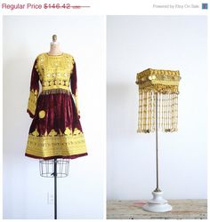 30% SALE / formal Afghan dress and hat - maroon velvet / heavily embroidered - traditional Pashtoon / Khyber costume by AgeofMint on Etsy https://www.etsy.com/listing/190526617/30-sale-formal-afghan-dress-and-hat