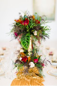 centerpiece with gold table runner - photo by Cotton Weddings http://ruffledblog.com/modern-romantic-holiday-shoot