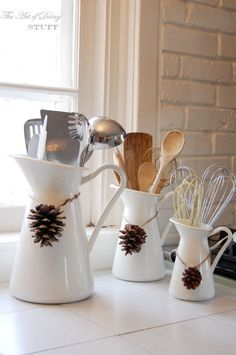 Love everything about this. The multiple pitchers for utensils. The pinecones. The simplicity.