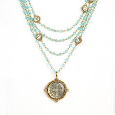 The Magdalena has been a VSA Classic as it is most versatile in style Wear open and long or layered The turquoise beads are reminiscent of sandy white beaches & Carribean oceans -Plated Bronze -Medallion is covered with a resin finish & is detachable - Length 12.5-14.5 inches plus medallion -Toggle Closure - Faceted Bicone crystals beads that add a POP of color -Handmade in San Miguel Allende Turquoise Water, Turquoise Beads, Turquoise Necklace, Crystal Beads, Crystals, White Sand Beach, Color Pop, Saints, Chokers
