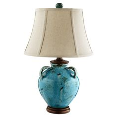 Jug-shaped table lamp with a bell shade.    Product: Lamp    Construction Material: Metal and fabric    Co...
