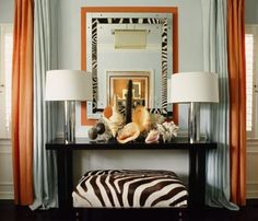 Palest of blues paired with orange and a splash of zebra.