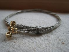 I found a tutorial for these on Youtube, and I am obsessed with making them. Mine look a little different than this one, but now I have a use for all my old guitar strings! :)