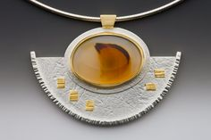Linda Lewis Jewelry - Bird Pendant ||  This is Montana Agate set in an 18k bezel on sterling that has been textured with handmade paper with a hammered edge. The bail is 14k gold with 22k accents. This pendant retails for $275.