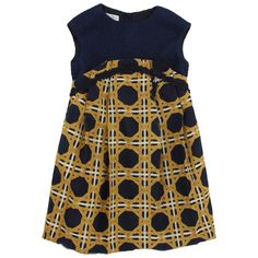 Sleeveless navy blue dress top. Embroidered organza voile bottom. Silken lining. Gold zip at the back.