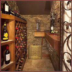 Custom-designed cedar wine storage genuine stacked stone and wrought-iron gates give this wine cellar the feel of a true grotto. & wine cellar under stairs | Home Decor | Pinterest | Wine cellars ...