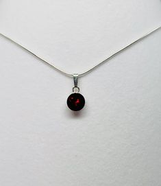 Set on a 925 Sterling Silver Chain is an necklace set with a Garnet Swarovski Crystal.  To compliment this we also have a matching 925 sterling silver stud earrings set with Garnet Swarovski Crystals and Garnet cufflinks.  This makes a stunning gift for Christmas, birthdays and anniversary.  Garnet is the January Birthstone colour and crystals are the anniversary gift for 15 years. Sterling Silver Earrings Studs, Sterling Silver Chains, Stud Earrings, Swarovski Crystal Necklace, Swarovski Crystals, 15 Years, Valentine Gifts, Necklace Set, Wedding Accessories