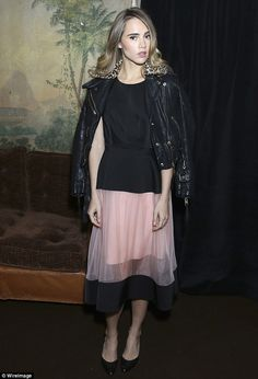 Stylish as ever: British beauty Suki dressed her lean and slender frame in a fur-trimmed l...