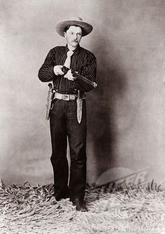 Bill Bennett, Wild West detective, armed with a rifle, revolver and knife. Ca. 1900.