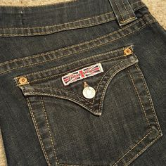 Hudson dark wash flare leg jeans In great shape, no stains or tears. Bottom of cuffs are still intact with no fraying whatsoever. Hudson Jeans Jeans Flare & Wide Leg