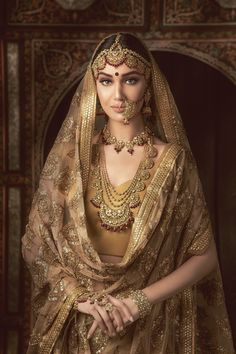 Jewelry OFF! Our craft is not merely a unique representation. It is a statement about our values our pride. An ode to our heritage curated for your milestone in your life. A labor of love crafted and given with love Sohani Collection. Indian Bridal Outfits, Indian Bridal Fashion, Indian Bridal Wear, Pakistani Bridal Dresses, Golden Bridal Lehenga, Wedding Dresses, Bridal Portrait Poses, Bridal Poses, Bridal Photoshoot