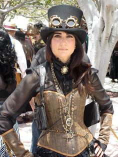 This is one of our clients looking tres steampunk at ComicCon San Diego in a custom faux leather corset with brass buckles and matching arm ...