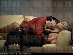 couple cuddling on the sofa - Google Search