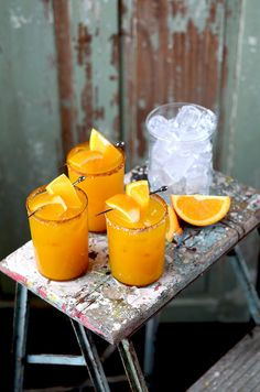 Orange Turmeric Margaritas   These are a sweet and smoky take on the classic cocktail. Homemade simple syrup. fresh juice and a salty, spiced rim make these drinks extra special but are still easy to make. @vintagekittycom