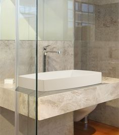 Complementing the Adrian tub, the Adrian SR lavatory sink is designed for semi-recessed application. To see more from MTI, check out ibathtile.com.