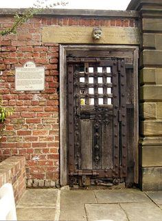 Ancient door from Newgate Prison in London now installed in the garden wall at Newby Hall, North Yorkshire.
