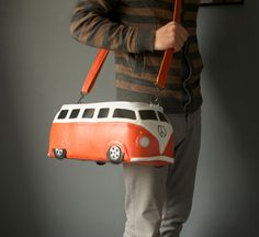 This bag is made by hand in a form of a cute orange and white VW bus. Decorated with silver prints and lovely windows.  = Exterior =  Made of