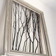 Branches wall art!  Just staple random branches into painted frame.