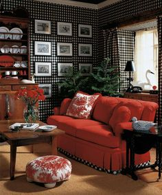 Love the red sofa and the check detail around the bottom of it. Love the wallpaper too. :-)