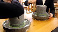 Manual matcha grinding by hand with grinding stone at Fukujuen, Uji (Japan)