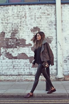 Gala of AMLUL looking #streetstyle chic in leather pants and a #leopard purse