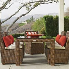 Why does this have to be four grand? :(   faux wicker patio furniture with red and whit cushions and pillows