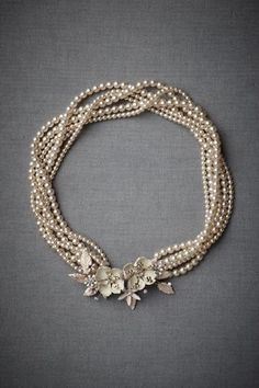 Pearls. Double or 4x my pearl long strands and put a rhinestone pin in middle.  Dramatic.
