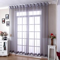 Modern grey sheer curtains are simple and generous. The color of smoky grey is very generous and the sheer can move with the wind, which can give you a sense of hazy. The sheer is cheap but has a good quality. Gray Sheer Curtains, Patterned Curtains, Decorative Curtain Rods, Pelmets, Elegant Living Room, Curtain Patterns, Grey, Simple, Modern