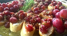 Roasted Red Grapes and Rosemary   Serve warm on crostinis + light layer of goat cheese.