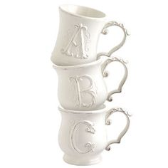 Our handsomely finished glazed earthenware mugs are embossed with your choice of initial and a sleek concave silhouette (letters a, e, f, h, i, l, k, n, t, u, v, x, y, z), or a jolly belly shape (letters b, c, d, g, j, m, o, p, q, r, s, w ). Drink up!