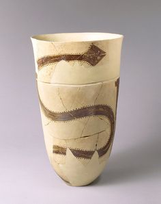TDO 6 - Boisseau aux serpents Iran - Suse I - 4200 à 3800 av. J.-C. Suse Terre cuite peinte H. : 30 cm. ; D. : 20,60 cm Paris, mdL.