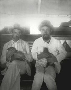 Anton Chekhov (right) aboard the Petersburg ship holding a mongoose, 1890