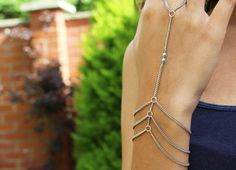A stunning statement hand harness, with delicate blue and silver bead embellishments - Available from: https://www.etsy.com/uk/listing/477821175/triple-blue-hand-harness-blue-ring?ref=shop_home_active_2