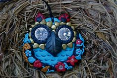 This owl and 'handmade with polymer resin, design and realization of Sonia Elia Creations artist