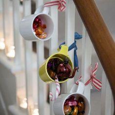 Christmas treats in ribbon-hung mugs