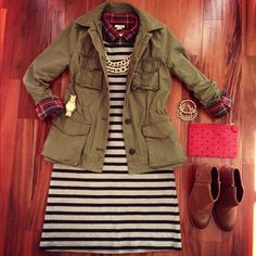 Cute fall layering outfit: plaid shirt underneath striped dress with army jacket and ankle boots