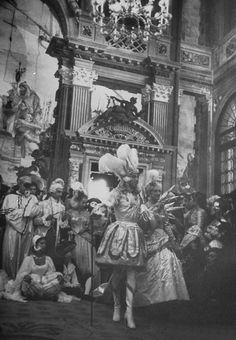 Couturier Jacques Fath, as Roi-Soleil, and his wife Geneviève arriving to Charles de Beistegui's Ball at Palazzo Labia in Venice. 1951