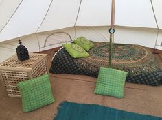 Glampit bell tent interior set up. Fair trade Indian furnishings