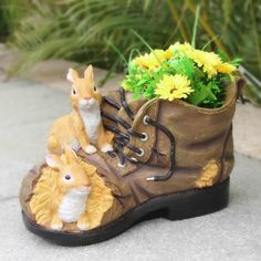Young guests will giggle with glee over the SINTECHNO Two Rabbits Nested in Shoe Flower Planter ! This statue shows a lucky pair of bunnies who have. Flower Planters, Flower Pots, Planter Pots, Big Plants, Exotic Plants, Growing Flowers, Planting Flowers, Potted Flowers, Rabbit Nest