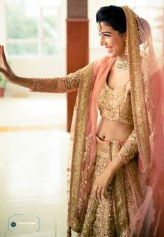 Wedding Photography - Candid Photo clicked of the real bride Suneet in her peach and gold shimmer lehenga. Courtesy : Shutterdown - Lakshya Chawla #wedmegood #indian #wedding #Photography #portrait