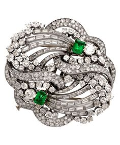 Emerald, Diamond and Platinum Double Clip Brooch, by Boucheron Paris, circa 1930. Of scroll design set with diamonds and emeralds mounted in platinum. Signed.