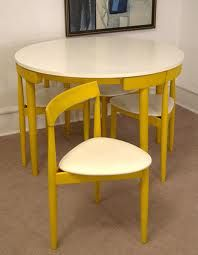 interesting....here is the Hans Olsen compact dinette set, but in a yellow and white instead of the teak. I sure hope it isn't because someone painted it! I will see if I can locate a sharper pic. Photo credit: midcentury modernist