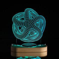 This LED Illusion Octopus Lamp resides somewhere between work of art and functional lighting fixture. Made from custom-engraved acrylic and a solid pine base, both parts are machined with Blue Pine's own CNC milling machine, then sanded and coated...